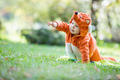 Cute baby girl dressed in fox costume crawling in park  - PhotoDune Item for Sale
