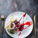 Grilled camambert cheese with jam and walnuts on white plate, restaurant meal, copy space. - PhotoDune Item for Sale
