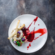 Grilled brie cheese with jam and walnuts on white plate, restaurant meal, copy space. - PhotoDune Item for Sale