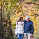 Free Download A portrait of a senior couple walking in an autumn nature. Copy space. Nulled