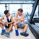 Free Download Young men in gym talking and resting after an exercise. Nulled