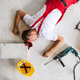Free Download An unconscious man worker lying on the floor after accident on the construction site. Nulled