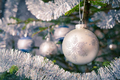 Christmas-tree decoration bauble on decorated Christmas tree bac - PhotoDune Item for Sale