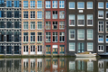 Amsterdam canal Damrak with houses, Netherlands - PhotoDune Item for Sale
