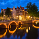 Amterdam canal, bridge and medieval houses in the evening - PhotoDune Item for Sale