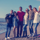 portrait of friends having fun on beach during autumn day - PhotoDune Item for Sale