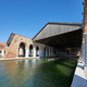 Venetian Arsenal with docks, wide canal and arcade in Venice, Italy - PhotoDune Item for Sale