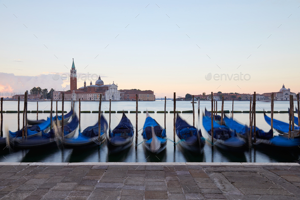 Gondolas movements and canal in Venice before sunset, Italy - Stock Photo - Images