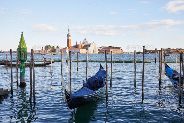 San Giorgio Maggiore island, basilica and gondola boats in Venice, Italy - Stock Photo - Images