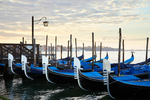 Gondolas in Grand Canal in the early morning in Venice, Italy - Stock Photo - Images