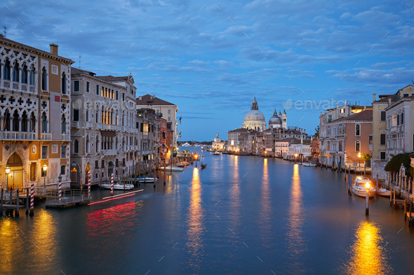 Grand Canal in Venice illuminated in the evening in Italy - Stock Photo - Images
