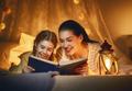 Family reading bedtime. - PhotoDune Item for Sale