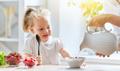 Happy family having breakfast. - PhotoDune Item for Sale