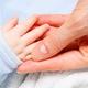 Hand of newborn baby in hand of mother - PhotoDune Item for Sale