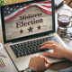 Businessman with a US of America midterm elections picture onscreen - PhotoDune Item for Sale