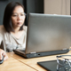 Asian girk office worker using laptop in office. - PhotoDune Item for Sale