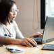Asian girl office worker using laptop in office. - PhotoDune Item for Sale