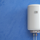 Electric boiler, water heater on the blue wall. - PhotoDune Item for Sale