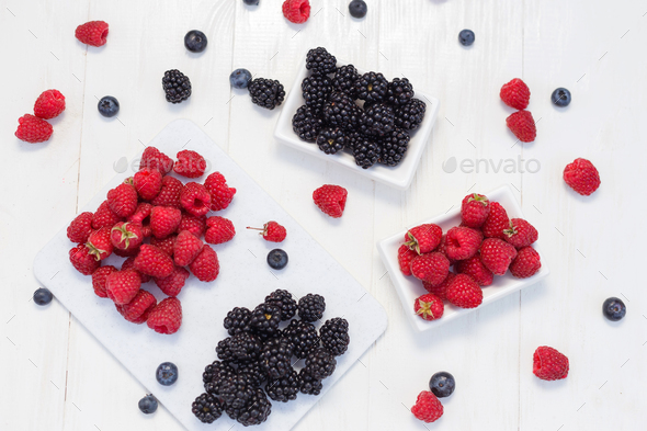 Blueberries, raspberries and blackberries on white background - Stock Photo - Images