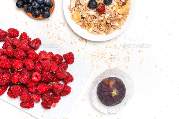Healthy breakfast. Food cereal concept with fresh fruits isolated on white - Stock Photo - Images
