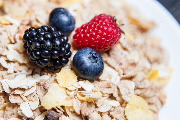 Healthy breakfast. Raspberries, blueberries, blackberries on a cereal - Stock Photo - Images