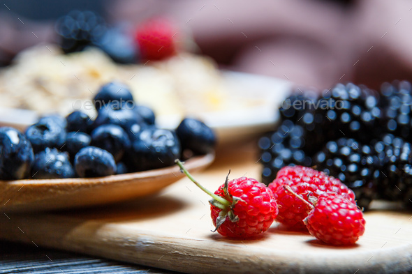 Berries mix blueberry, raspberry on rustic wooden table - Stock Photo - Images