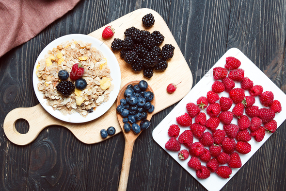 Cereal. Breakfast with muesli and berries. Top view, flat lay - Stock Photo - Images