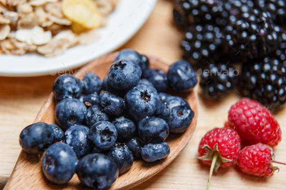 Fresh organic blueberries and raspberries in a basket.Blueberry and raspberry - Stock Photo - Images