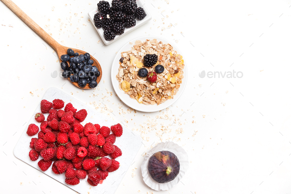 bowl of corn flakes with berries on white background. - Stock Photo - Images