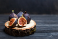 sliced fig fruits on a wooden board - PhotoDune Item for Sale