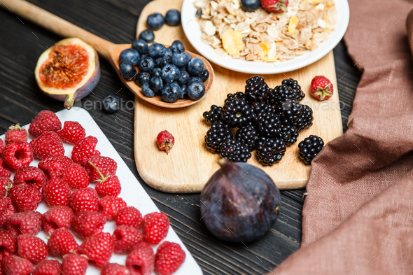 Healthy breakfast with muesli and berries. Top view, flat lay - Stock Photo - Images