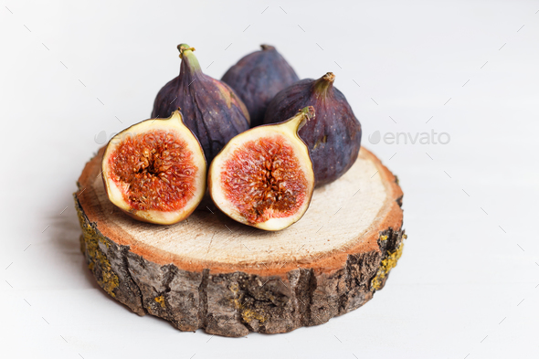 A few figs in a bowl on an old wooden background. - Stock Photo - Images