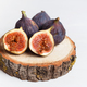 A few figs in a bowl on an old wooden background. - PhotoDune Item for Sale