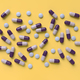 colorful pills isolated on yellow background - PhotoDune Item for Sale