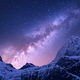 Purple milky Way above snowy mountains. Space - PhotoDune Item for Sale