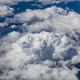 Cloudscape background. View out of an airplane window. - PhotoDune Item for Sale