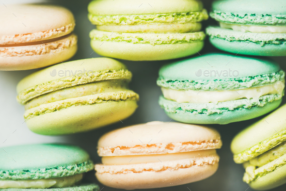 Pastel colored French macaroons cookies over light background - Stock Photo - Images