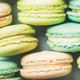 Pastel colored French macaroons cookies over light background - PhotoDune Item for Sale