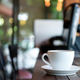White coffee cup on wooden floor in cafe. - PhotoDune Item for Sale