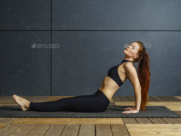Sitting yoga with a beautiful redhead woman - Stock Photo - Images
