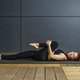 Gorgeous redhead woman stretching in the gym - PhotoDune Item for Sale