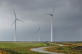 road between wind turbines on cloudy day - PhotoDune Item for Sale