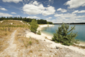 turquoise lake water and blue sky in summer - PhotoDune Item for Sale