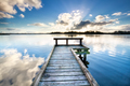 wooden pier on big lake and blue sky - PhotoDune Item for Sale