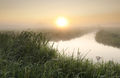 misty sunrise over river in countryside - PhotoDune Item for Sale