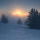 foggy sunrise on snowy mountain top - PhotoDune Item for Sale