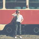 Carefree hipster girl posing with tram in background - PhotoDune Item for Sale