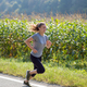 woman jogging along a country road - PhotoDune Item for Sale