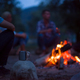 young friends relaxing around campfire - PhotoDune Item for Sale