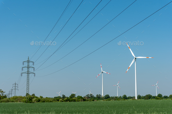 Overhead power lines and wind energy plants - Stock Photo - Images